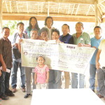 Mayana Small Farmers Association receive their cash assistance for the Bottoms-Up Budgeting project Bongan Banana Rehabilitation and Expansion
