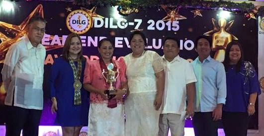Ms. Helencita Galbo with DILG 7 executives and Engr. Judy Grace Dominguez, Jagna MLGOO.